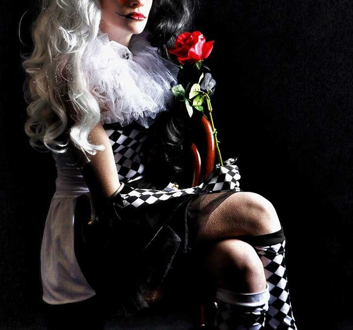 Harlequin With A Rose